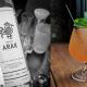 bottle of Oregon arak and arak cocktail